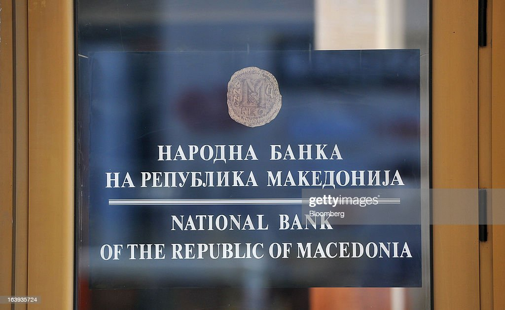 A sign sits on a doorway at the headquarters of Macedonia's central bank in Skopje, Macedonia, on Sunday, March 17, 2013. Macedonia's economy contracted by a real 0.3% on the year in 2012, compared to a growth of 2.8% a year earlier, an estimate released by the country's statistics office showed. Photographer: Oliver Bunic/Bloomberg via Getty Images
