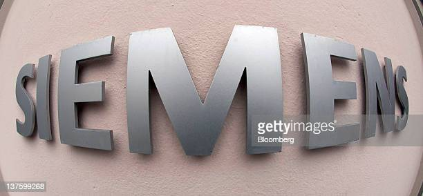 A sign sits on a wall outside the entrance to Siemens AG's headquarters in Munich Germany on Monday Jan 23 2012 Siemens AG has earmarked more than 1...