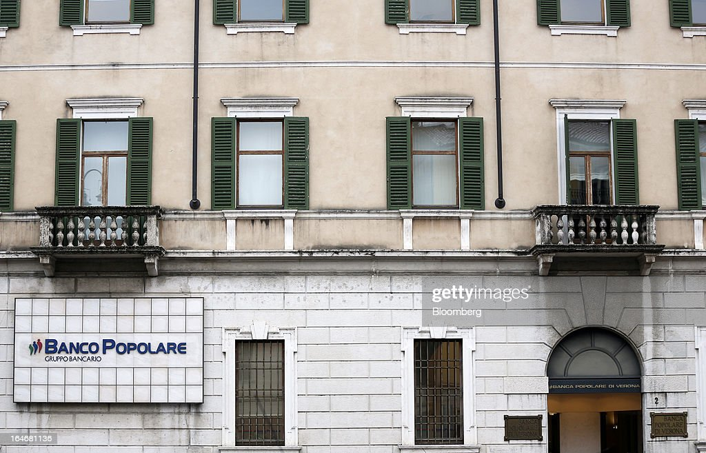 A sign sits on a wall outside the headquarters of Banco Popolare SC in Verona, Italy, on Monday, March 25, 2013. Italy's economy remains mired in its longest recession in two decades and a month-old political impasse threatens to increase sovereign-debt yields and bank funding costs. Photographer Alessia Pierdomenico/Bloomberg via Getty Images