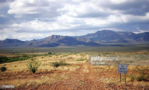 A sign sits on Cattle Rancher Jack Ladd's side of the USMexico border that abuts his 14000acre ranch 02 August in Palominas Arizona Ladd's property...
