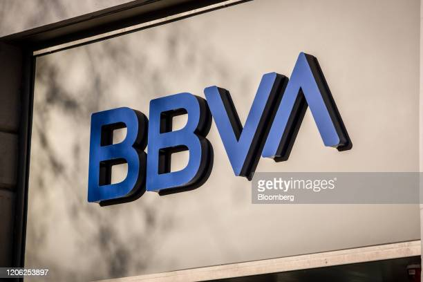 A sign sits on display above the entrance to a Banco Bilbao Vizcaya Argentaria SA bank branch in Barcelona Spain on Saturday March 7 2020 Spanish...
