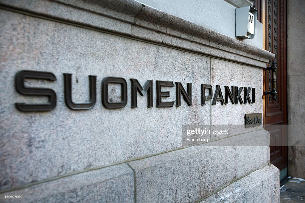 A sign sits on display outside the entrance to the Finnish central bank in Helsinki, Finland, on Thursday, Jan. 17, 2013. The pace of Finland's debt growth is alarming and the country must undertake economic reforms together with reining in spending, Finnish Prime Minister Jyrki Katainen said in an op-ed piece published in newspaper Savon Sanomat. Photographer: Ville Mannikko/Bloomberg via Getty Images