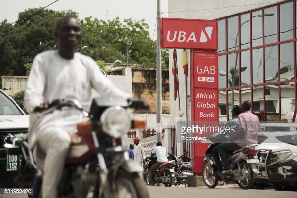A sign sits on display outside the headquarters of the United Bank of Africa Plc in N'Djamena Chad on Tuesday Aug 15 2017 African Development Bank...