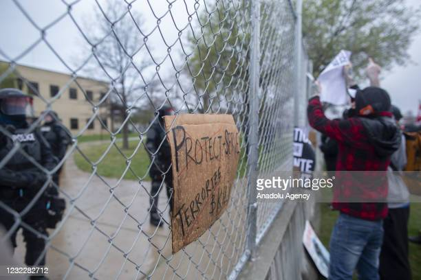 Sign sits on the fence surrounding the Brooklyn Center police department after the police killing of Daunte Wright in Brooklyn Center, Minnesota,...