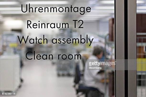 A sign sits on the glass door entrance to the watch assembly room clean room at the Mondaine Watch Ltd production facility in Solothurn Switzerland...