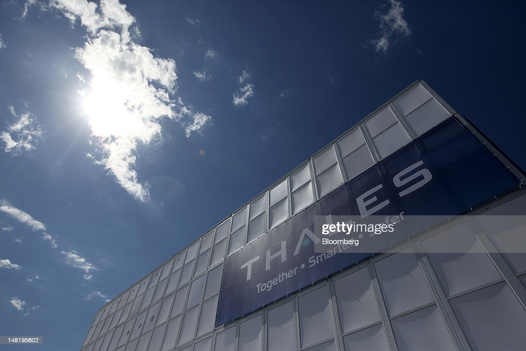 A sign sits on the outside wall of Thales SA's stand on the third day of the Farnborough International Air Show in Farnborough, U.K., on Wednesday, July 11, 2012. The Farnborough International Air Show runs from July 9-15. Photographer: Chris Ratcliffe/Bloomberg via Getty Images