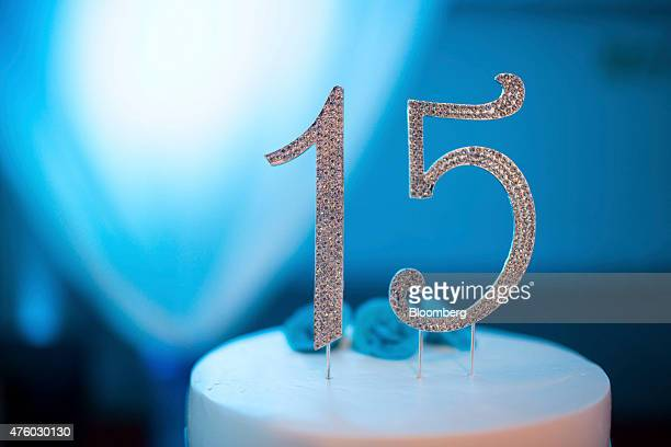 A '15' sign sits on the top of the cake at a quinceanera celebration at the Melia Cohiba hotel in Havana Cuba on Saturday March 28 2015 The loosening...