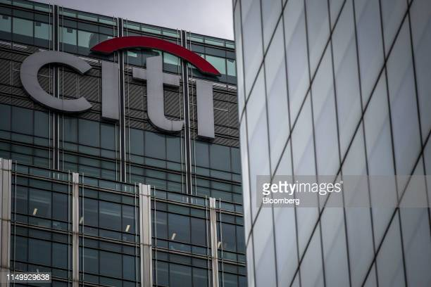 Sign sits on top of the skyscraper housing the Citigroup Inc. Offices at 25 Canada Square in the Canary Wharf business, financial and shopping...