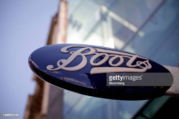 A sign sits outside a Boots store operated by Alliance Boots in London UK on Tuesday June 19 2012 Walgreen Co the largest US drugstore chain said it...