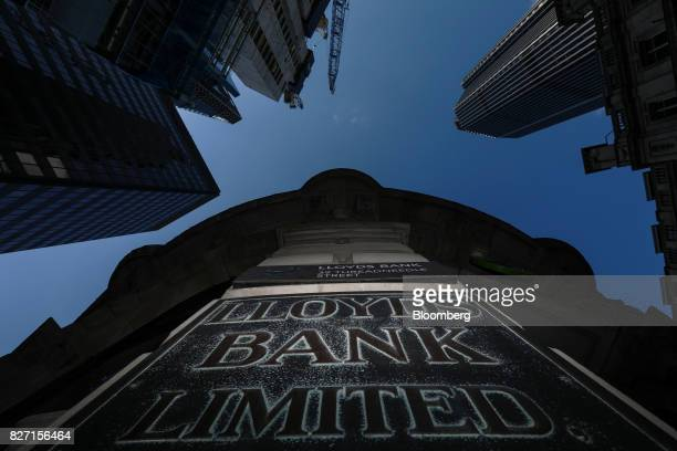 A sign sits outside a Lloyds bank branch a unit of Lloyds Banking Group Plc in London UK on Friday Aug 4 2017 Lloyds is in talks to lease a new...