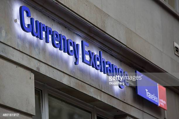 A sign sits outside a Travelex UK Ltd currency exchange in London UK on Monday Aug 24 2015 European stocks rallied with US equityindex futures after...