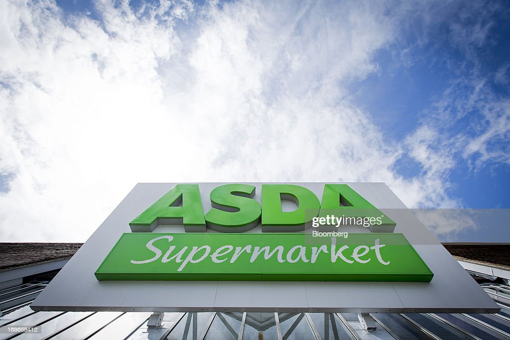 A sign sits outside an Asda supermarket store, operated by Wal-Mart Stores Inc., in the Richmond-upon-Thames borough of London, U.K., on Monday, May 13, 2013. Asda, the U.K. supermarket chain owned by Wal-Mart Stores Inc., said sales rose 4.5 percent last year and it's investing 700 million pounds ($1 billion) into stores and online operations. Photographer: Jason Alden/Bloomberg via Getty Images