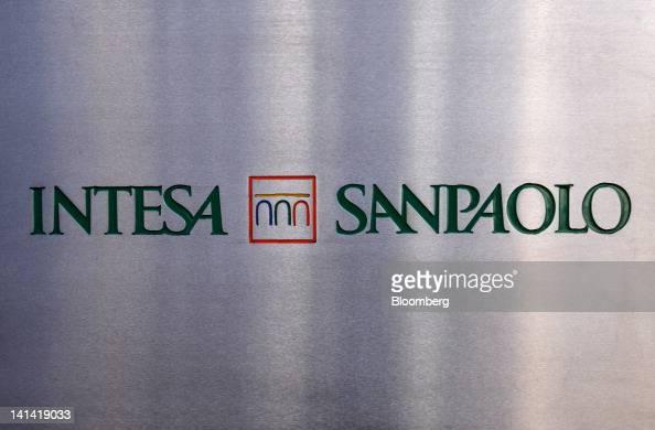 A sign sits outside the entrance to the Intesa Sanpaolo SpA