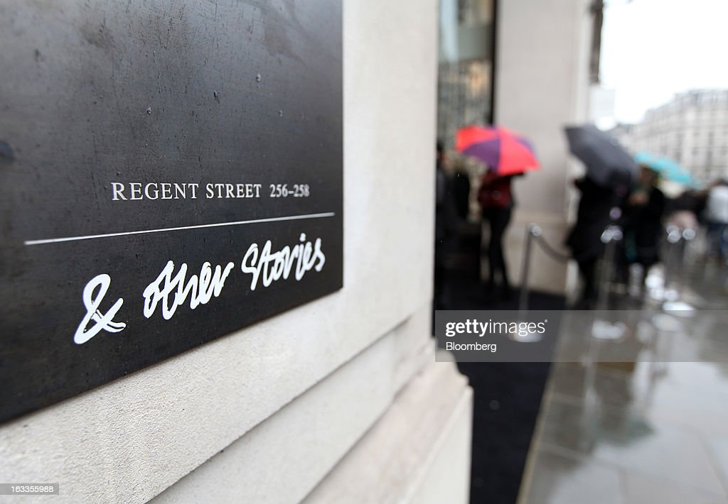A sign sits outside the entrance to the new '& Other Stories' store operated by Hennes & Mauritz AB (H&M) on the launch day in London, U.K., on Friday, March 8, 2013. The Swedish retailer is diversifying with a sixth brand after falling behind larger competitor Inditex SA in the race for the price-sensitive fashionista's euro. Photographer: Chris Ratcliffe/Bloomberg via Getty Images