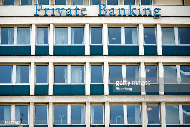 A sign sits outside the offices of Lloyds TSB Private Banking offices part of Lloyds Banking Group Plc in Geneva Switzerland on Wednesday June 5 2013...