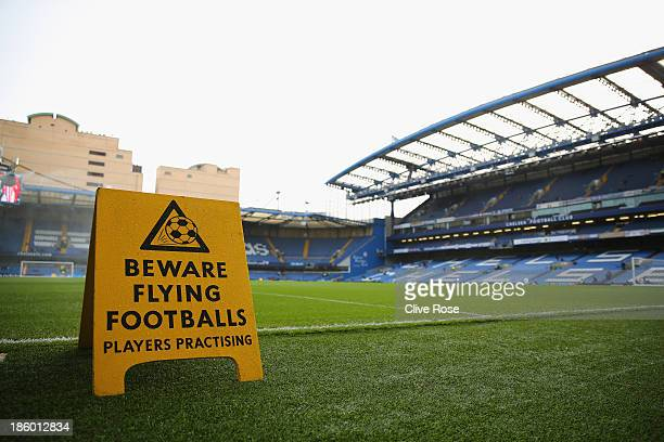 A sign sits pitchside warning fans of flying balls ahead of the Barclays Premier League match between Chelsea and Manchester City at Stamford Bridge...