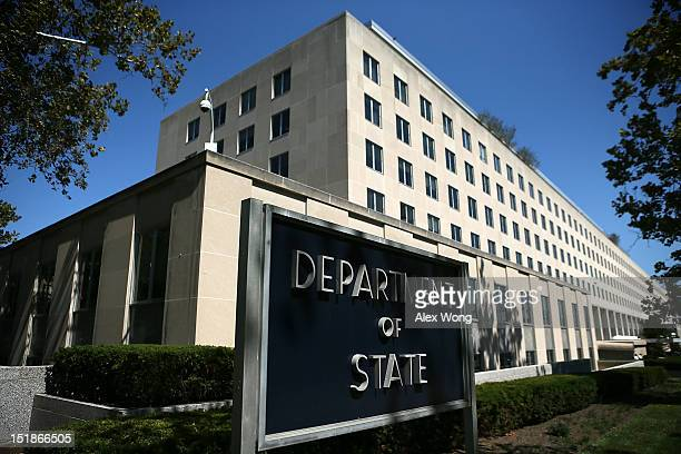 A sign stand outside the US State Department September 12 2012 in Washington DC US Ambassador to Libya J Christopher Stevens and three other...
