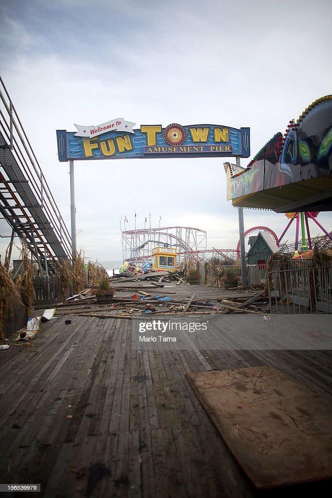 A sign stands above the heavily damaged Funtown Pier on November 16, 2012 in Seaside Heights, New Jersey. Two amusement piers and a number of roller coasters were destroyed in the seaside town by Superstorm Sandy.