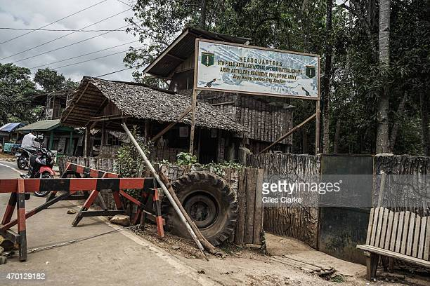 A sign stands at the entrance of a military checkpoint on the road out of Isabela City March 27 2015