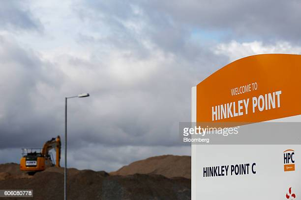A sign stands at the entrance to the Hinkley Point C nuclear power station operated by Electricite de France SA's near Bridgwater UK on Friday Sept...