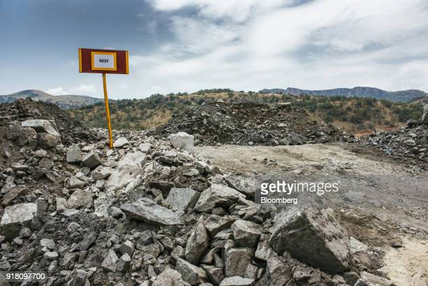 A sign stands by a stockpile of raw aluminum containing ore mined from the Upper Group 2 Reef platinum rich rock layer at the Northam Platinum Ltd...