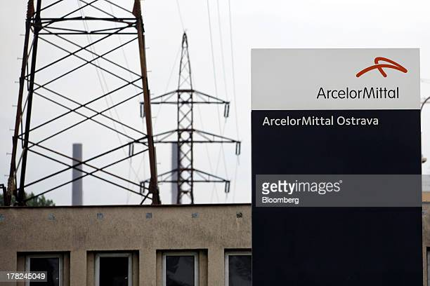 Sign stands near electricity pylons supporting power transmission lines leading away from ArcelorMittal's steel plant in Ostrava, Czech Republic, on...