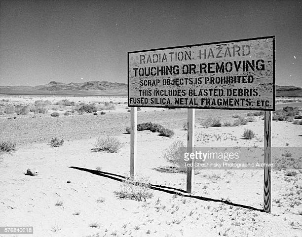 A sign stands on Frenchman's Flat where nuclear weapons tests took place in Mercury Nevada | Location Mercury Nevada USA