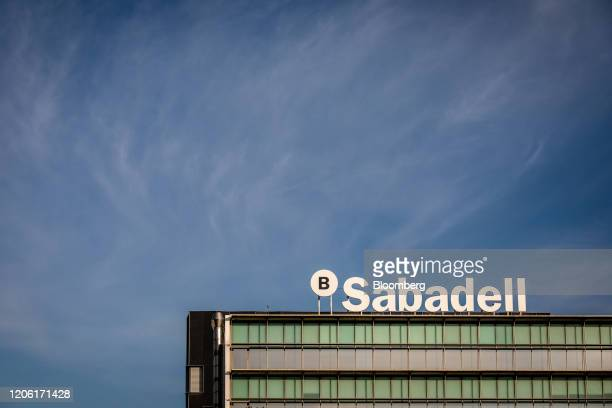 A sign stands on the roof of the Banco de Sabadell SA headquarters in Barcelona Spain on Thursday March 5 2020 Spanish bank shares soared after the...