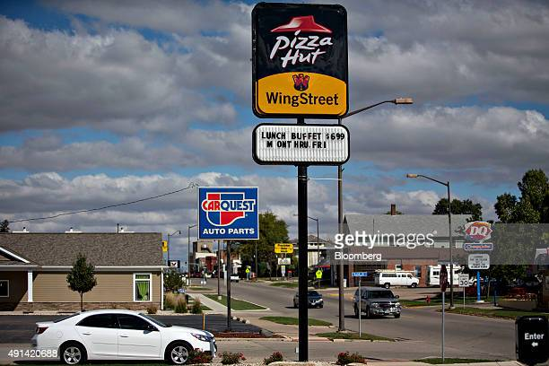 A sign stands outside a Pizza Hut restaurant in Princeton Illinois US on Thursday Oct 1 2015 Yum Brands Inc owner of the Taco Bell Pizza Hut and KFC...