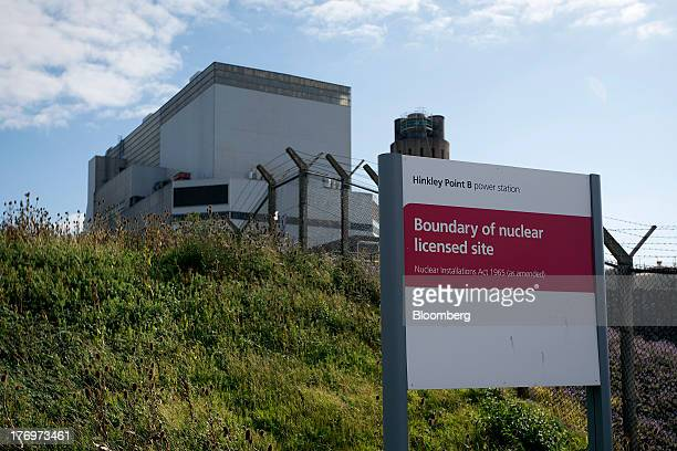 A sign stands outside Electricite de France SA's Hinkley Point B nuclear power station near Bridgwater UK on Monday Aug 19 2013 EDF's plans to build...