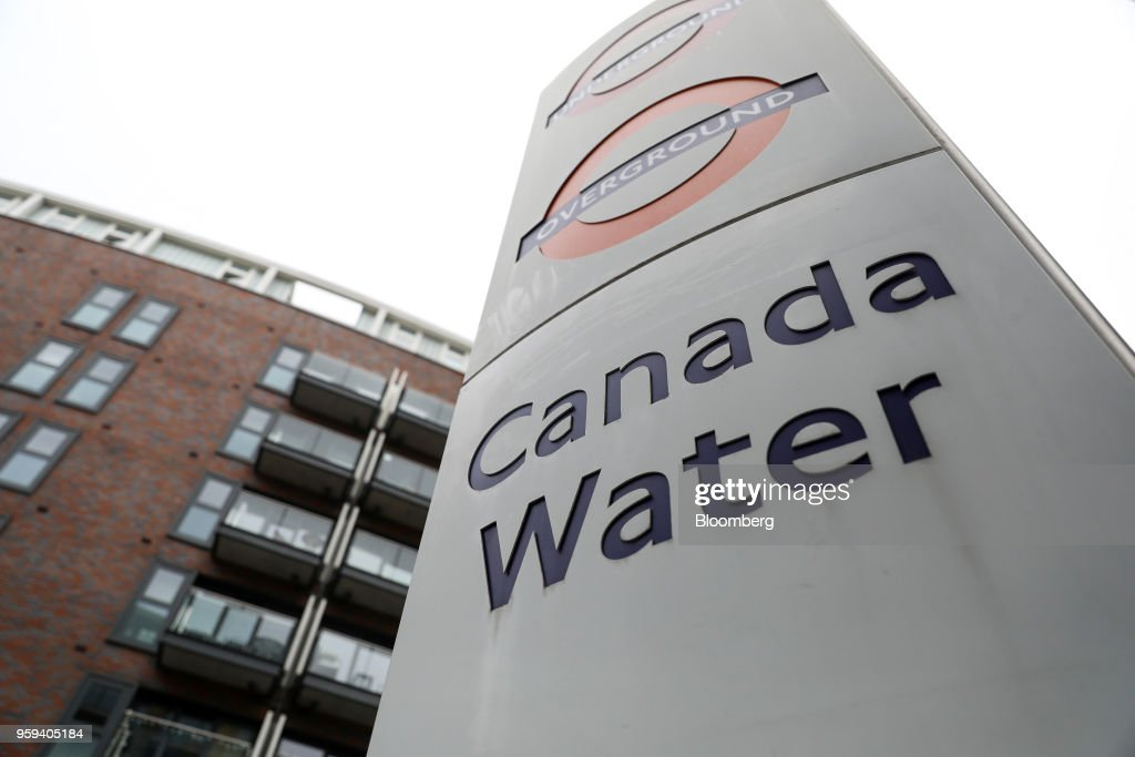 A sign stands outside the Canada Water station in London, U.K., on Wednesday, May 16, 2018. British Land Co. will seek approval to develop as many as 3,000 homes and work space equivalent to almost four Gherkin skyscrapers on a plot in south Londons Canada Water. Photographer: Chris Ratcliffe/Bloomberg via Getty Images