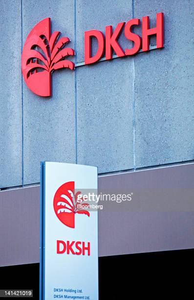 A sign stands outside the entrance to the headquarters of DKSH Holding Ltd in Zurich Switzerland on Friday March 2012 Shareholders of DKSH which has...