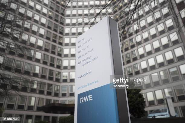 A sign stands outside the headquarters of RWE AG in Essen Germany on Tuesday March 13 2018 EON SE will shed as many as 5000 jobs in the deal to take...