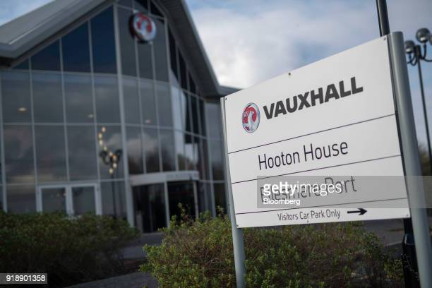 A sign stands outside the Hooton House offices of Vauxhall Motors Ltd owned by PSA Group in Ellesmere Port UK on Monday Feb 5 2018 Being split off...