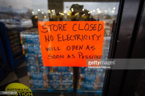Sign states that a Fiesta Mart is closed because of a power outage in Austin, Texas on February 17, 2021. Millions of Texans are still without water...
