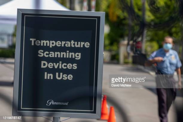 Sign stating that temperature scanning devices are in use is seen at Paramount Pictures Studios as Los Angeles County allows more businesses and...
