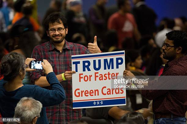 A sign suggesting Republican presidential candidate Donald Trump supports expediting work visas is seen during a Hindu political organization's...