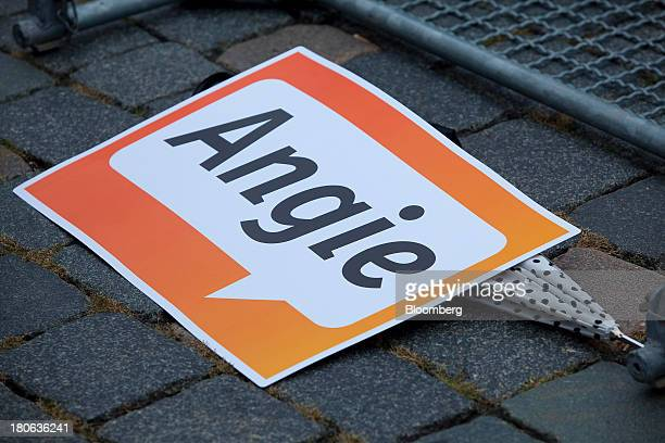 A sign supporting Angela Merkel Germany's chancellor and party leader of the Christian Democratic Union lays on the ground at an election rally in...