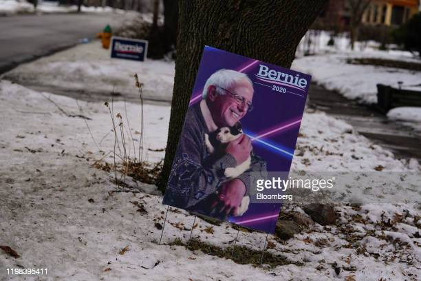 A sign supporting Senator Bernie Sanders an Independent from Vermont and 2020 presidential candidate stands in a yard in Des Moines Iowa US on Monday...