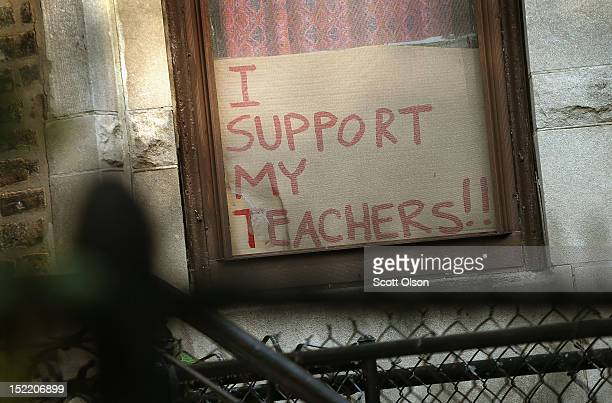 A sign supporting teachers sits in the window of a home across the street from the Jose De Diego Community Academy on September 17 2012 in Chicago...