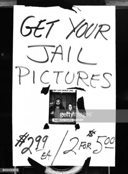 A sign taped on a window in Daytona Beach Florida during the city's 1983 Bike Week advertises souvenir 'jail pictures' The annual motorcycle event...