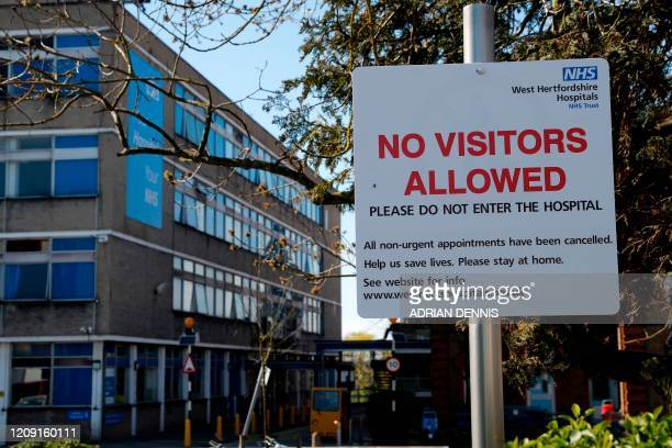 A sign telling people that all nonurgent appointments are cancelled is pictured outside Watford General Hospital in north west London on April 5 as...
