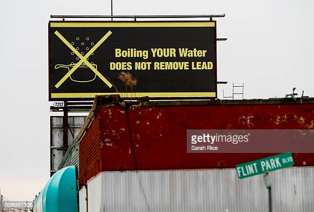 A sign tells Flint residents that boiling water doesn't remove lead on February 7 2016 in Flint Michigan Months ago the city told citizens they could...