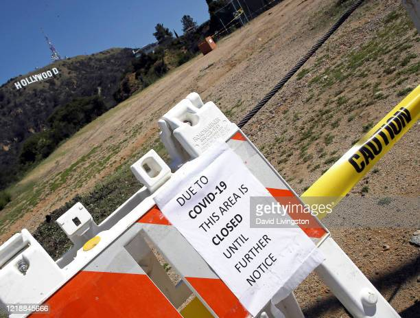 Sign tells of area closure with a view of the Hollywood Sign in the background on April 14, 2020 in Los Angeles, California. Worldwide, the...