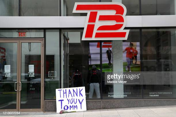 A sign thanking former New England Patriots quarterback Tom Brady sits outside the TB12 Performance Recovery Center on March 17 2020 in Boston...