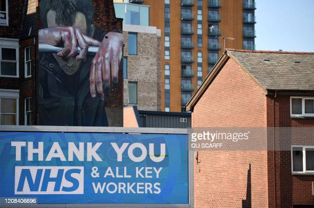 A sign thanking NHS workers is seen in Manchester north west England on March 27 2020 Britain was under lockdown its population joining around 17...