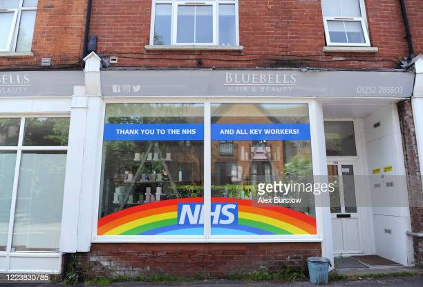 A sign thanking the NHS and key workers is seen on display in a hair and beauty shopfront on May 09 2020 in Fleet England The UK is continuing with...