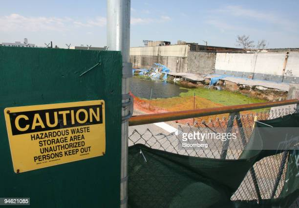 A sign that reads CAUTION HAZARDOUS WASTE STORAGE AREA hangs outside a toxic waste site in the Gowanus section of Brooklyn where Whole Foods Market...