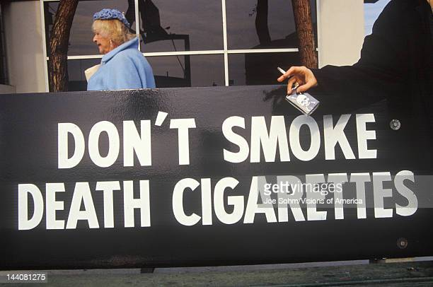 A sign that reads 'Don't smoke death cigarettes'