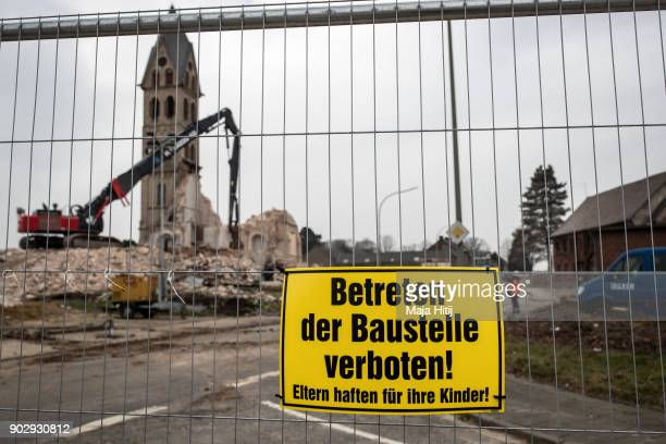 Sign that reads 'Entrance forbidden' is seen during a demolition of Saint Lambertus church following protests by activists on January 9 2018 in...